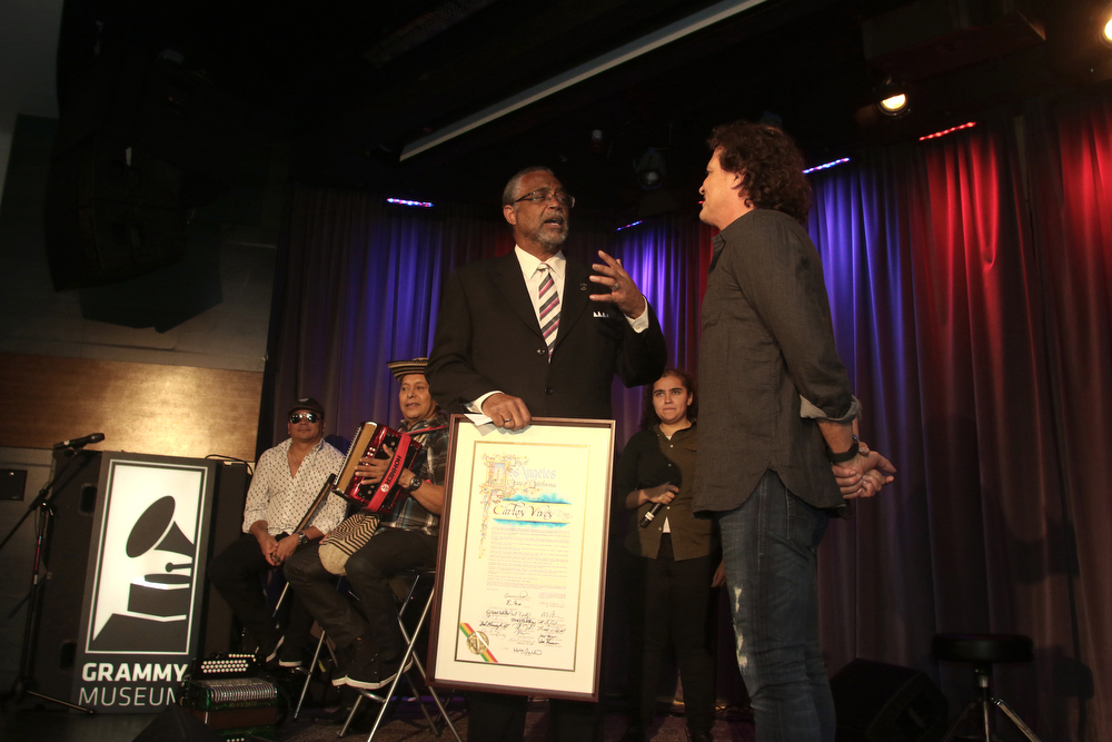 Singer Carlos Vives and 4h Graders from Para Los Niños make music at The Grammy Museum on October 23, 2015 in Los Angeles, California (Photo by Jc Olivera)